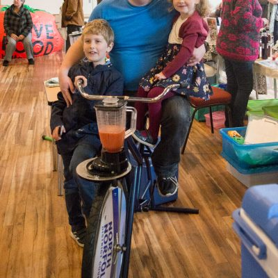 Adam Payne with his children Toby, aged eight and Sophie, four, test a Smoothie Bike.