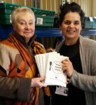 2016: Ella King (right) receives the booklets from Mo Anderson-Dungar.